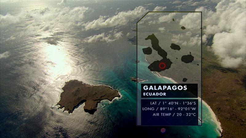 A coastal region with fog rising from the sea. Caption: Galapagos Ecuador. Latitude, 1 degree 40 minutes North. Longitude, 89 degrees 16 minutes to 92 degrees 01 minutes West. Air Temperature, 20 to 32 degrees Celsius.
