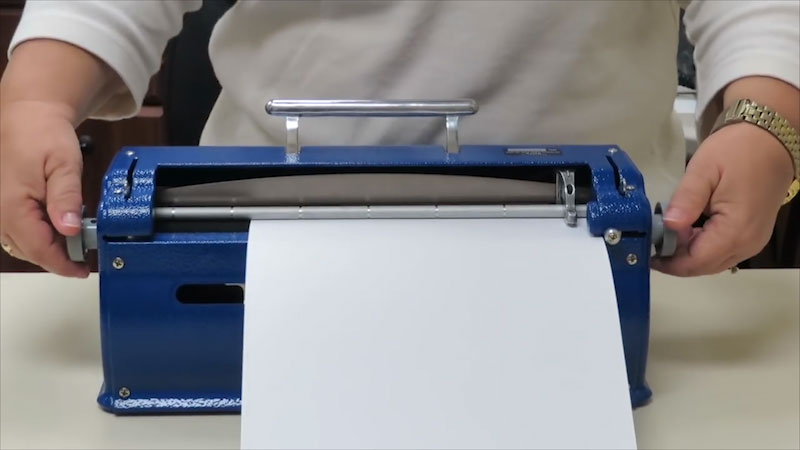 Still image from: How to Load Paper Into the Perkins Brailler