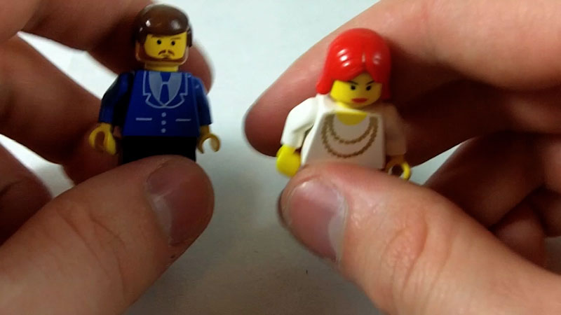 Still image from: How to Build LEGO Newscasters Phil and Sherry