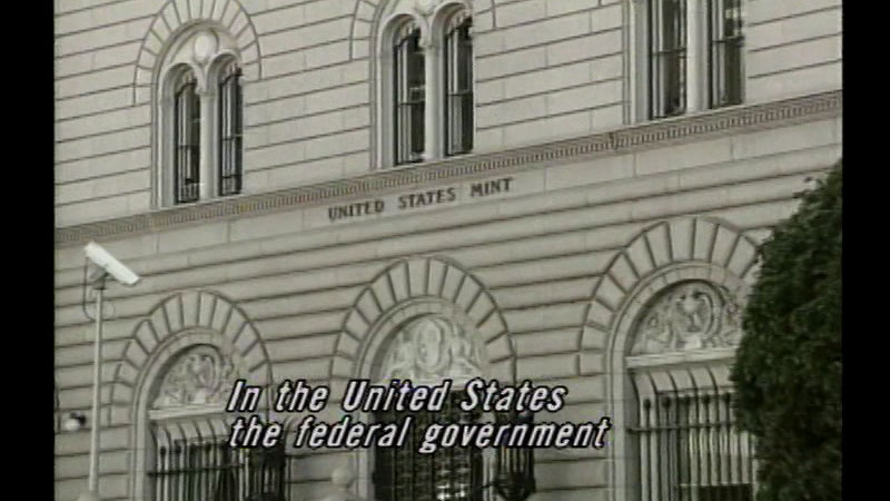 Still image from: The Money People