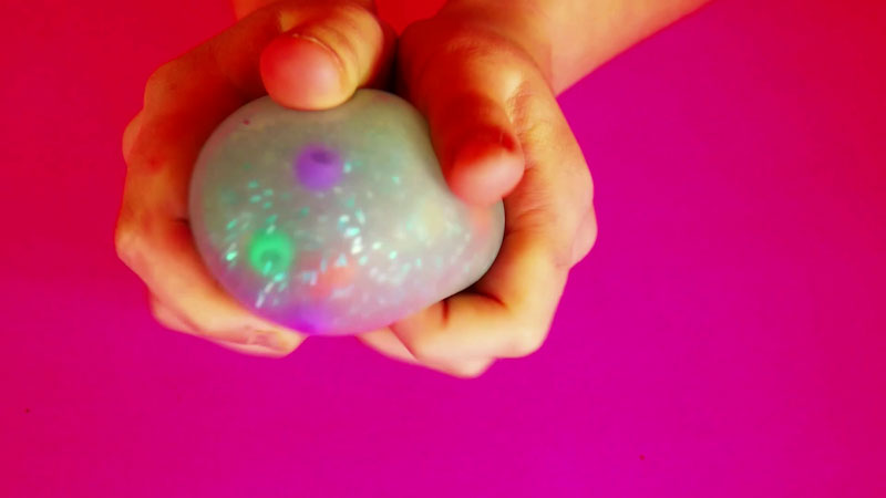 Still image from: DIY Glitter Squishy Balls! How to Make Clear Stress Balls!