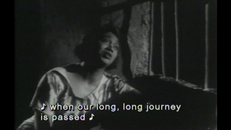 Still image from: Song of Freedom