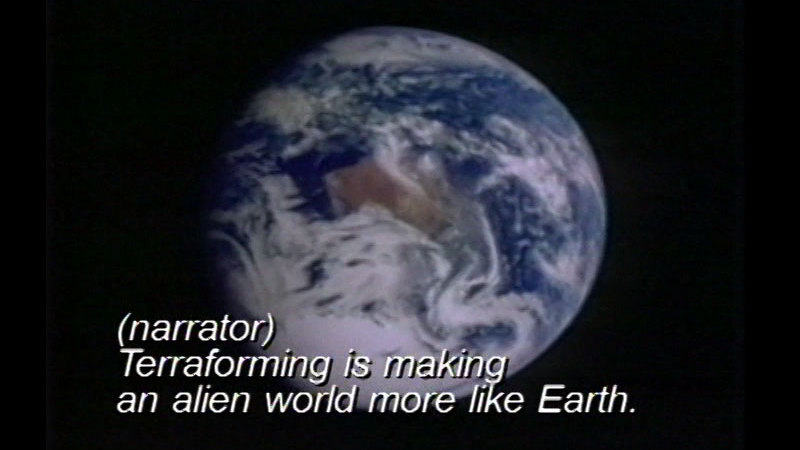 Earth as seen from space. Caption: (narrator) Terraforming is making an alien world more like Earth.