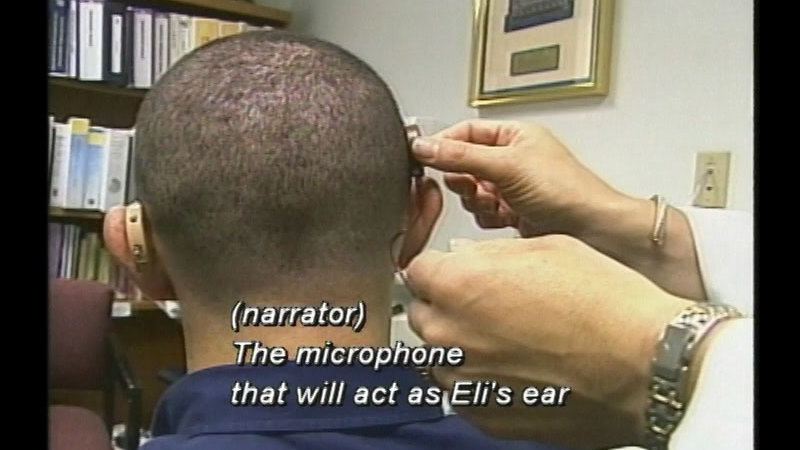 Still image from: Eli's Story: Learning to Hear