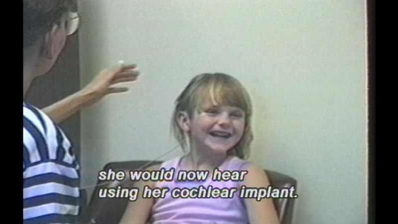 Still image from Summer's Story: Coming Of Age With The Cochlear Implant