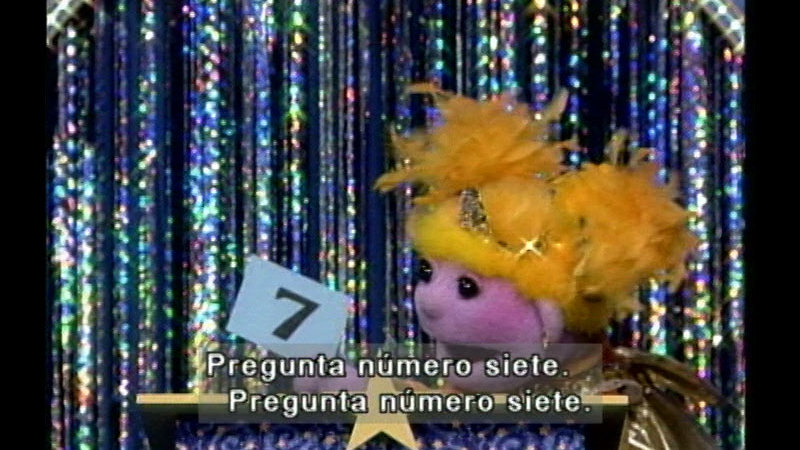 Still image from: Salsa 206: Quiz Show: What Is It This Time? (Spanish)