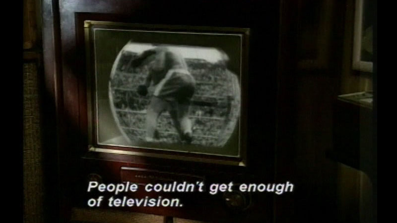 Black and white television set. Caption: People couldn't get enough of television.