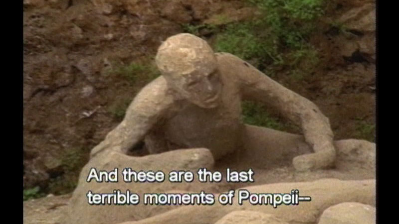 Excavated preserved status of a person collapsed on the ground. Caption: And these are the last terrible moments of Pampeii--
