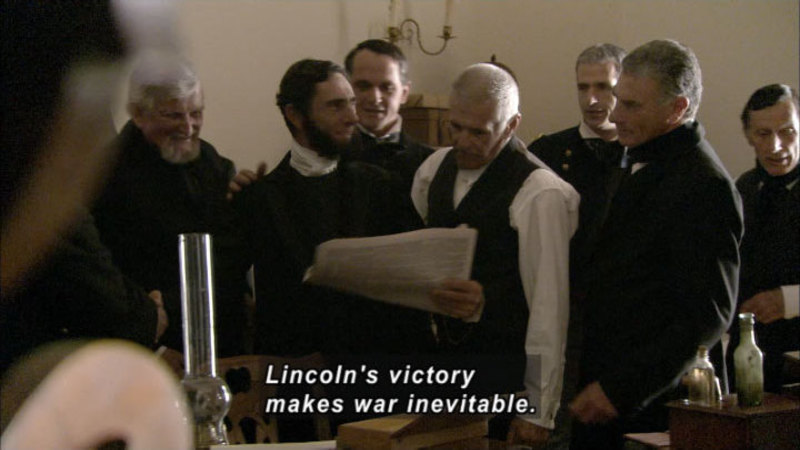 Men in waistcoats stand clustered together, looking at papers being held by one of them. Caption: Lincoln's victory makes war inevitable.