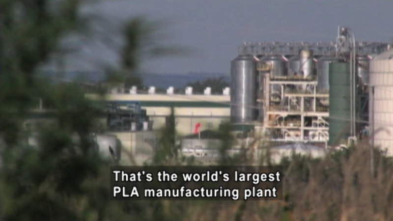 Industrial plant from a distance. Caption: That's the world's largest PLA manufacturing plant.