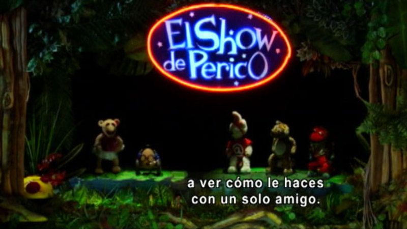 Five puppets on a stage. Spanish captions.
