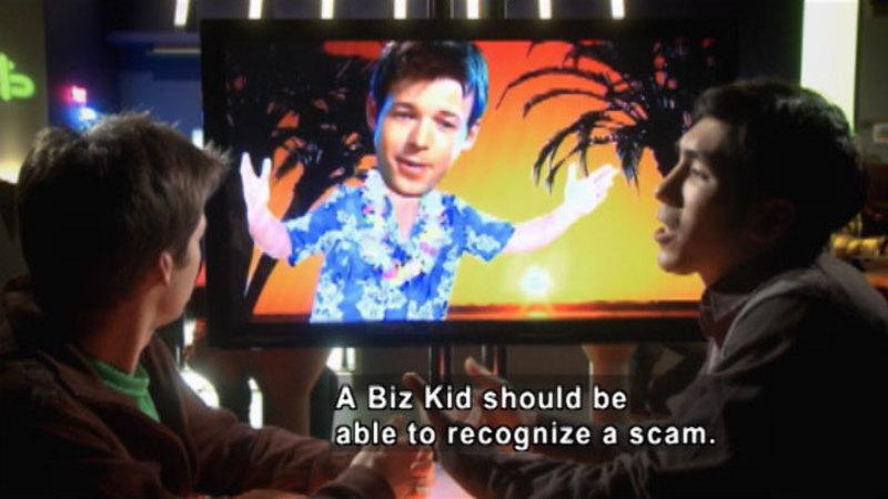 Still image from: Biz Kid$: Scam-O-Rama