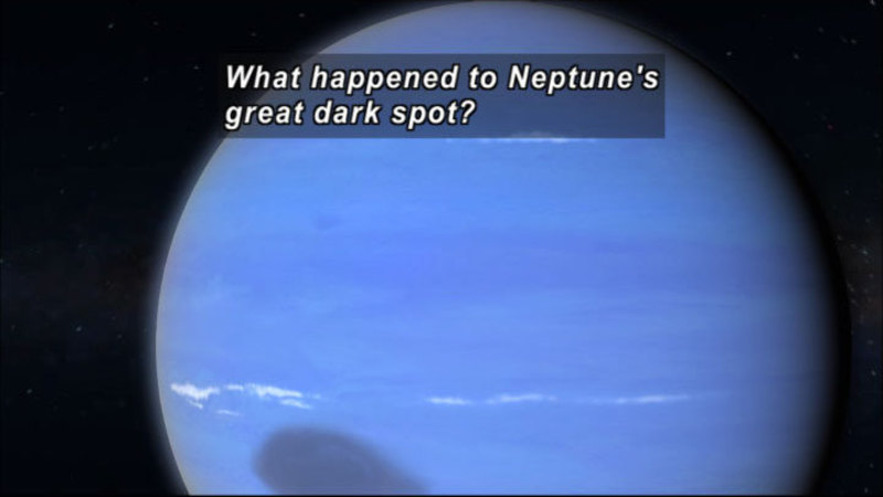 Close up view of Neptune in space. Caption: What happened to Neptune's great dark spot?