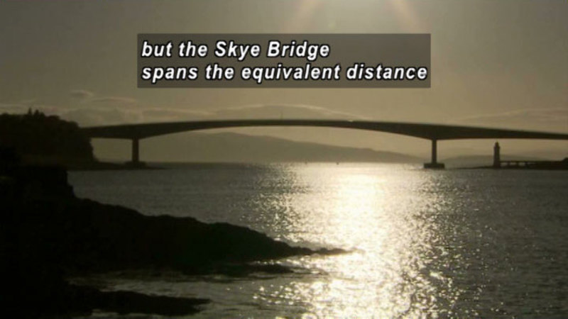Gently arching bridge over a large body of water. Caption: but the Skye Bridge spans the equivalent distance
