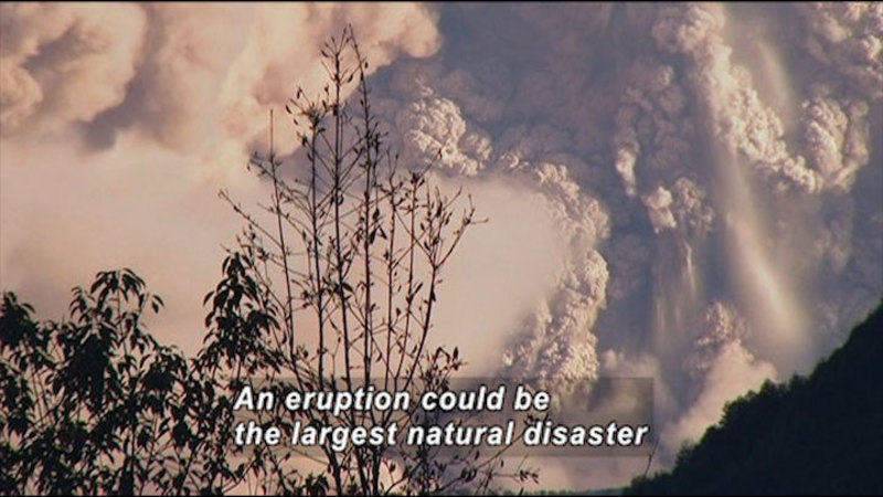 Ash from an eruption filling the air. Caption: An eruption could be the largest natural disaster