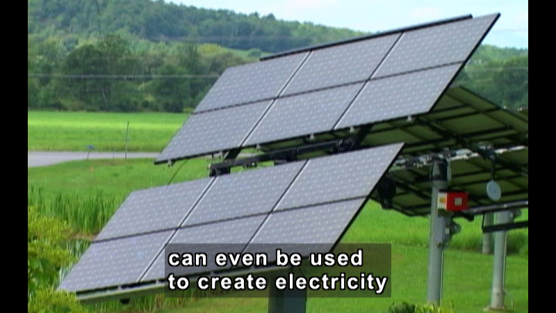 Solar panels tilted toward the sky. Caption: can be used to create electricity