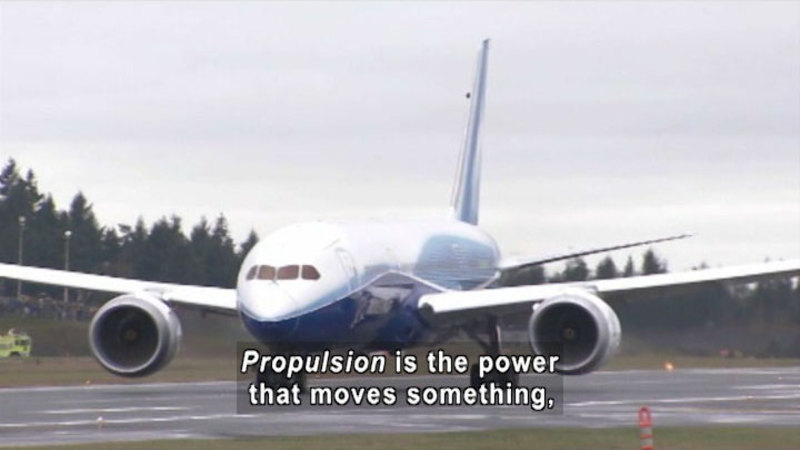 Large plane taxiing on a runway. Caption: Propulsion is the power that moves something,