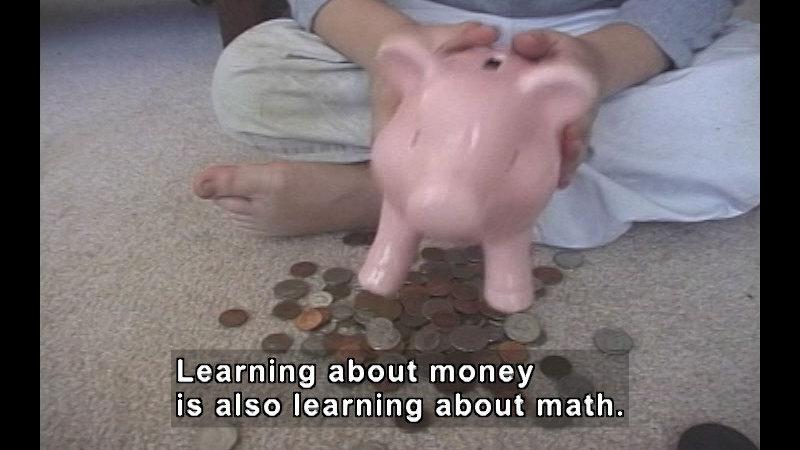 Still image from: Money