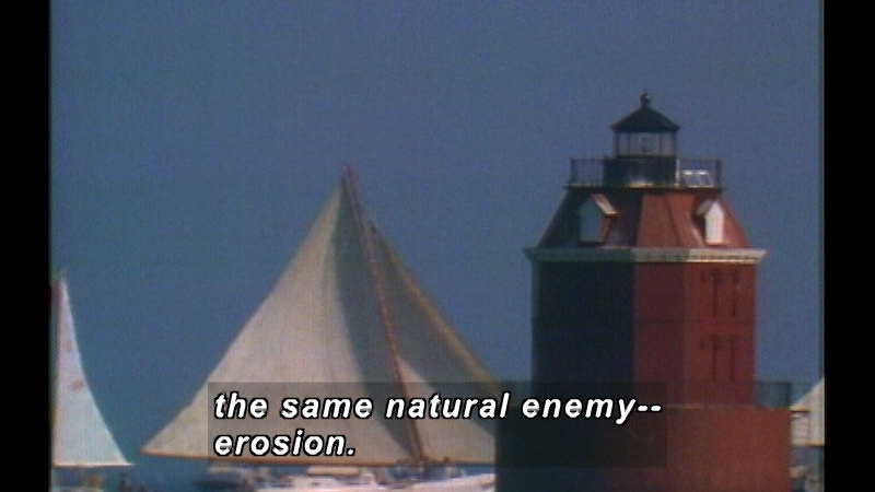 A lighthouse with the sails of ships in the background. Caption: the same natural enemy-- erosion.