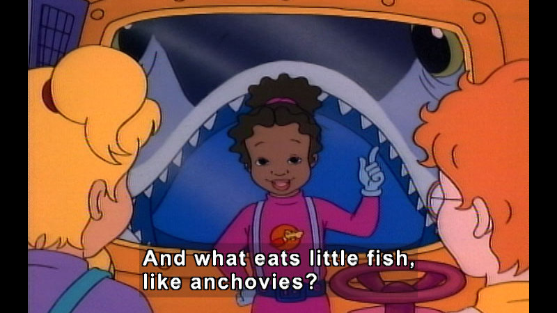 People inside the magic school bus with a giant fish opening its mouth to swallow them visible through the window outside. Caption: And what eats little fish, like anchovies?