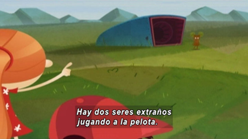 Person pointing towards a small creature. Spanish captions.