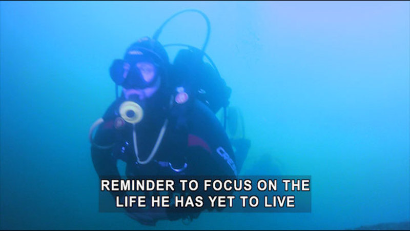 Person in scuba gear underwater. Caption: reminder to focus on the life he has yet to live