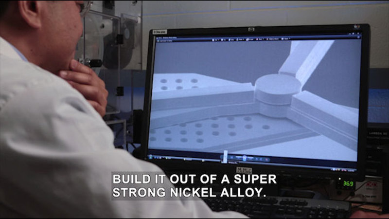 Person at a computer screen which displays a three-rotor windmill. Caption: Build it out of a super strong nickel alloy.