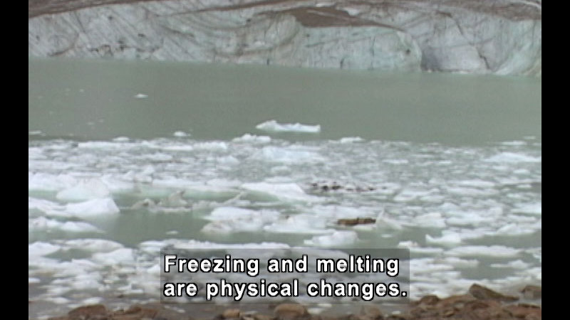 Water with chunks of ice floating in it. Caption: Freezing and melting are physical changes.