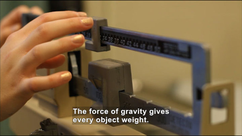 A sliding scale weighing something. Caption: The force of gravity gives every object weight.