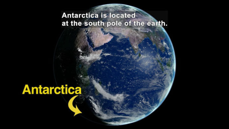 View of Earth from space. Caption: Antarctica is located at the south pole of the earth.