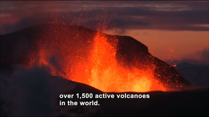 Mouth of volcano mid explosion. Caption: over 1,500 active volcanoes in the world.