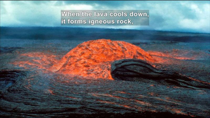 Lava cooling down. Caption: When lava cools down, it forms igneous rock,