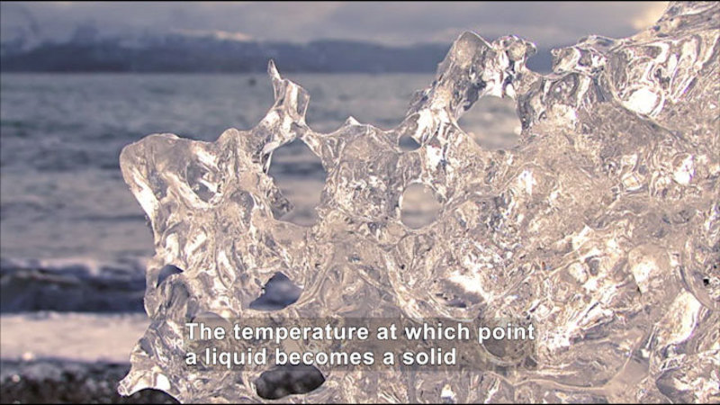 A large formation of ice. Caption: The temperature at which point a liquid becomes a solid