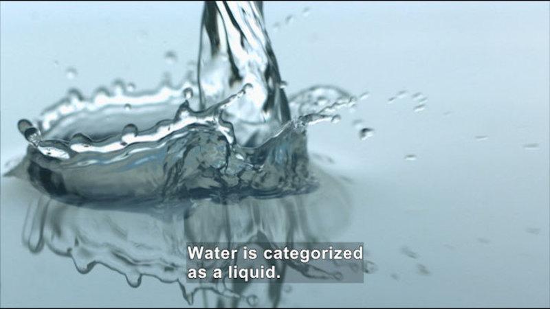 Splash of water. Caption: Water is categorized as a liquid.