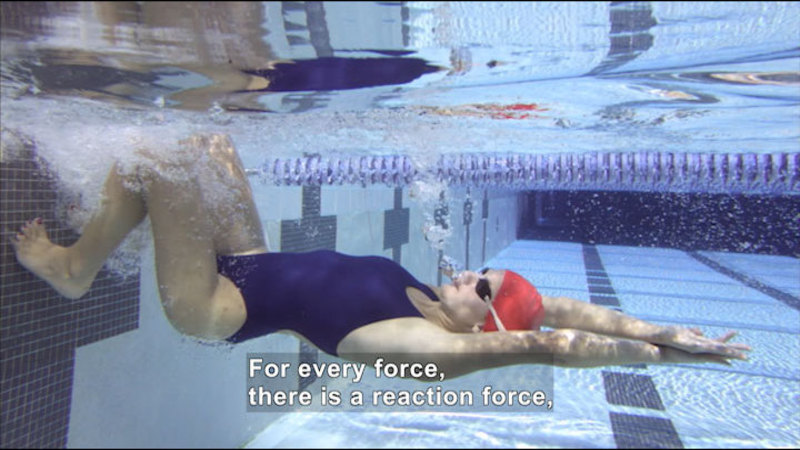 Woman swimming in pool. Caption: For every force, there is a reaction force,