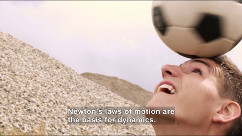 Man balancing soccer ball on his head. Caption: Newton's laws of motion are the basis for dynamics.