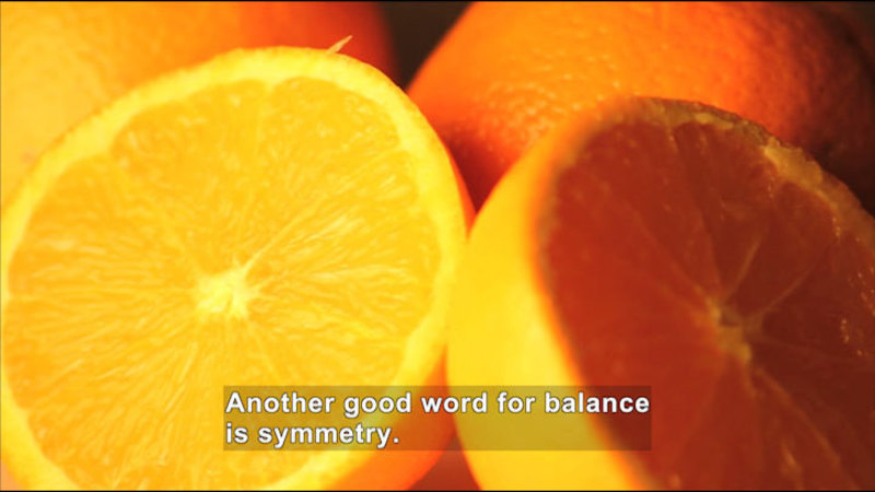 An orange cut in half. Caption: Another good word for balance is symmetry.