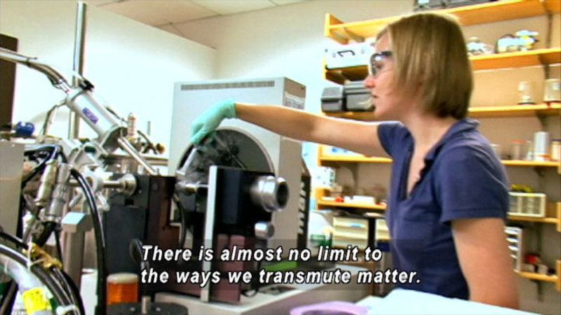 Person in a science lab working with complex machinery. Caption: There is almost no limit to the ways we transmute matter.