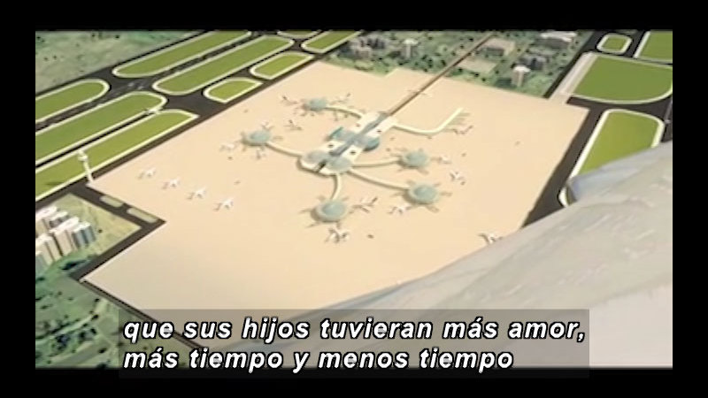 Model of an airport surrounded in green spaces. Spanish captions.