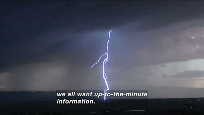 Bolt of lightning arcing from cloud to ground. Caption: we all want up-to-the-minute information.