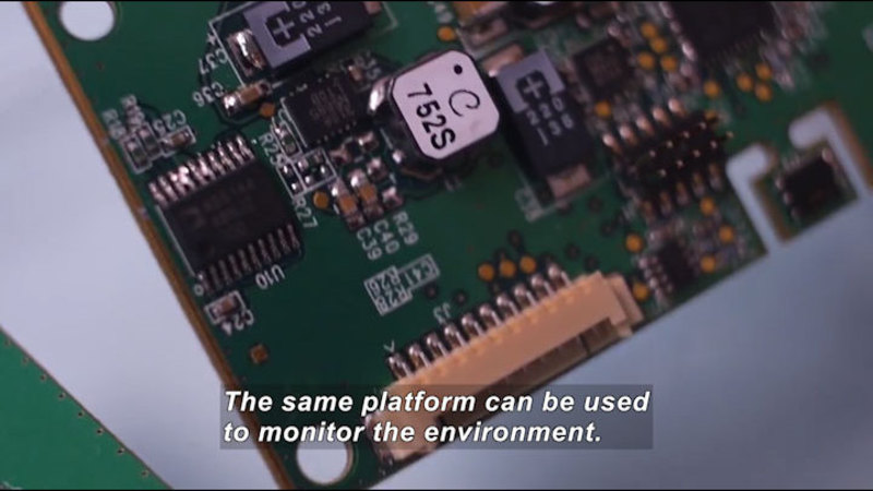 Closeup of a circuit board. Caption: The same platform can be used to monitor the environment.