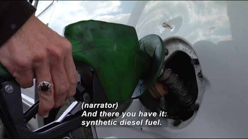 Person pumping fuel into a vehicle. Caption: (narrator) And there you have it: synthetic diesel fuel.