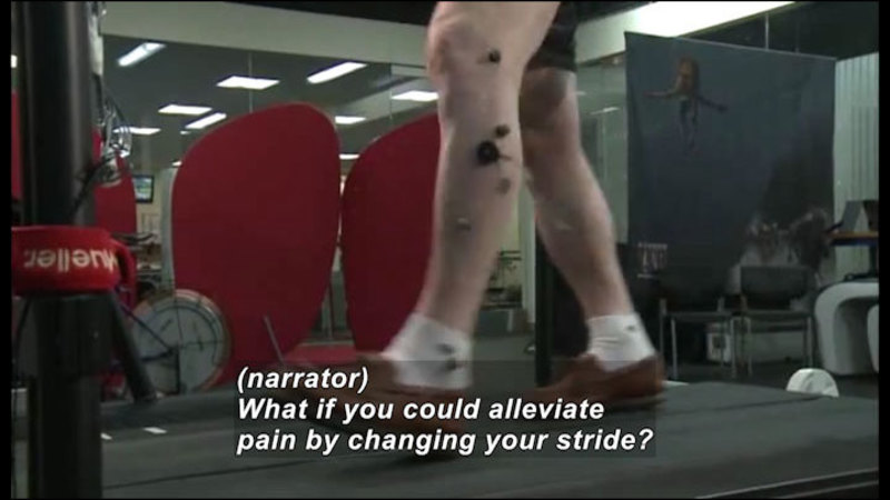 Person walking on a treadmill with sensors attached to their legs. Caption: (narrator) What if you could alleviate pain by changing your stride?
