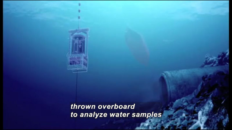 Floating metal measurement instrument in deep blue water. Caption: thrown overboard to analyze water samples