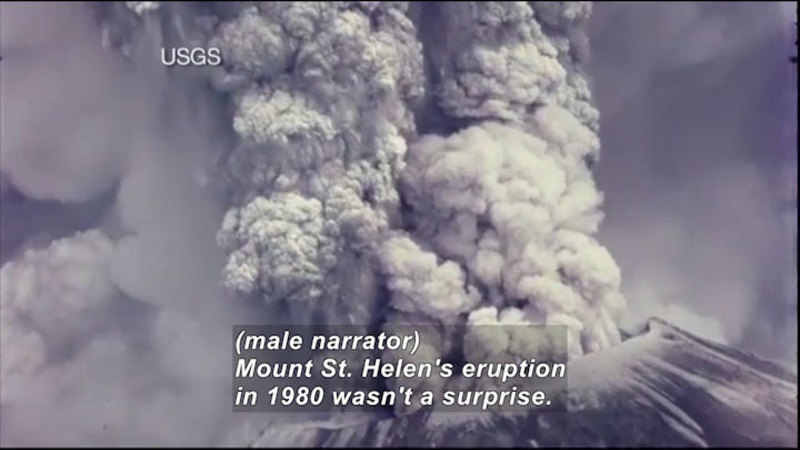 Volcano billowing smoke and ash. Caption: (male narrator) Mount St. Helen's eruption in 1980 wasn't a surprise.