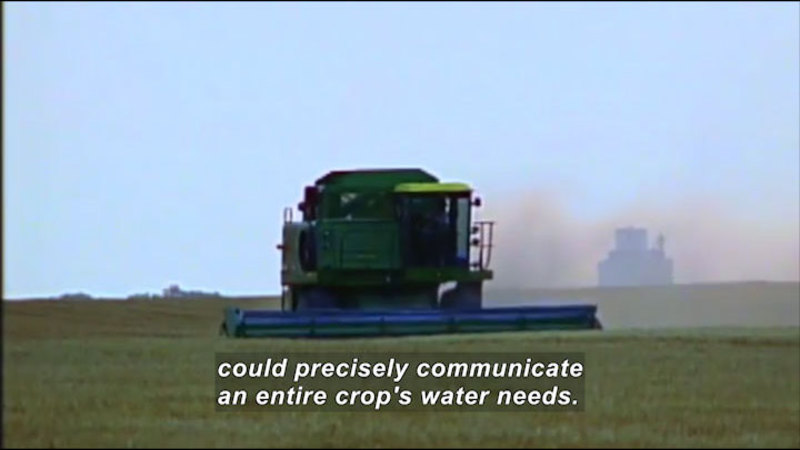 Large industrial machine moving across a cultivated field. Caption: could precisely communicate an entire crop's water needs.