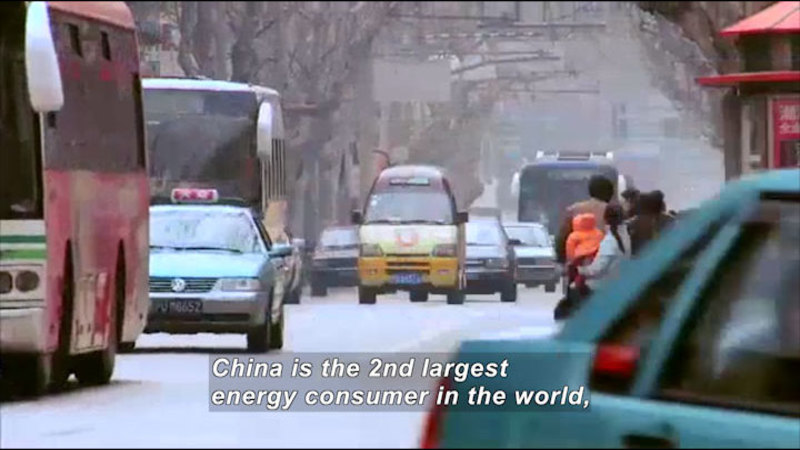 Smoggy city street crowded with vehicles. Caption: China is the 2nd largest energy consumer in the world,