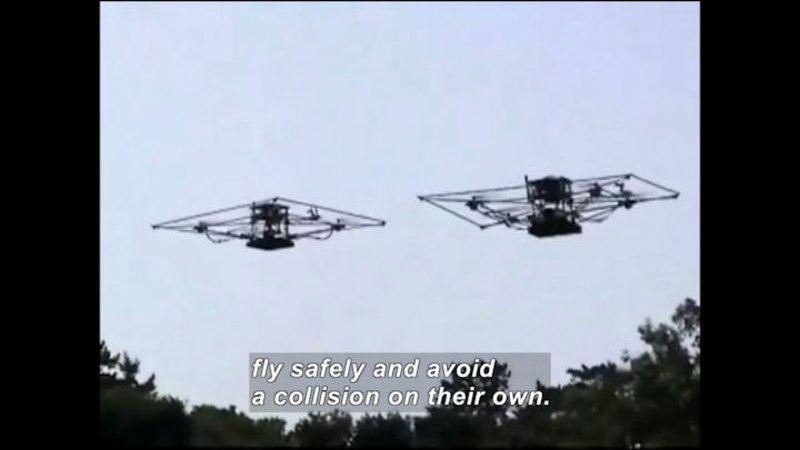 Two rectangular drones flying in the air. Caption: fly safely and avoid collision on their own.