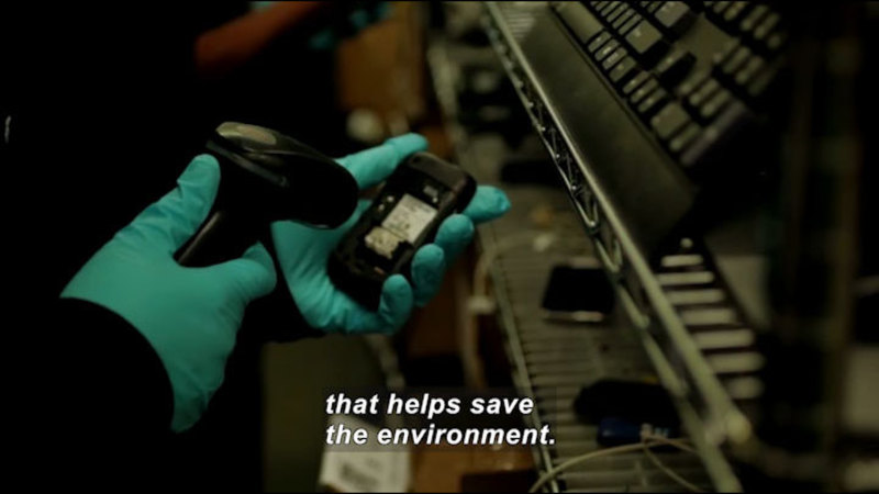 Still image from: Scientists & Engineers On Sofas (And Other Furnishings): Flip Phones Save The World