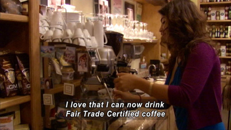 Person at an expresso machine in a shop. Caption: I love that I can now drink Fair Trade Certified coffee